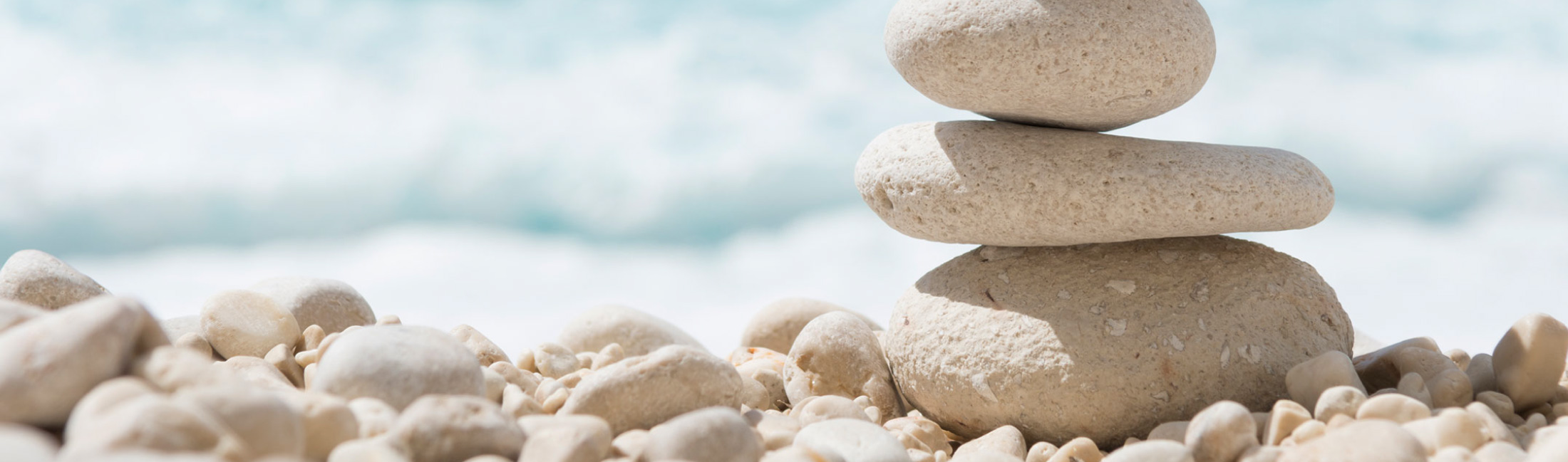 Balanced Pharma background - stones balanced on beach